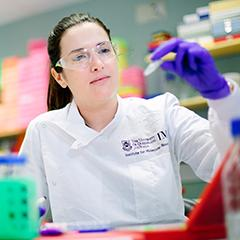 Dr Rebecca Coll in the lab