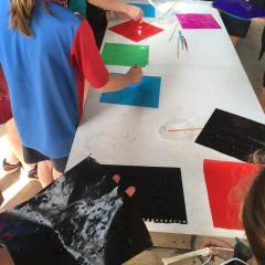 Students participating in a crystal painting activity as part of Catch a Rising Star program