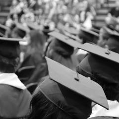 University graduates with caps and gowns - researchers have found that the length of your formal education is linked to your genes.