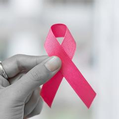 Breast Cancer Awareness - hand holding pink ribbon